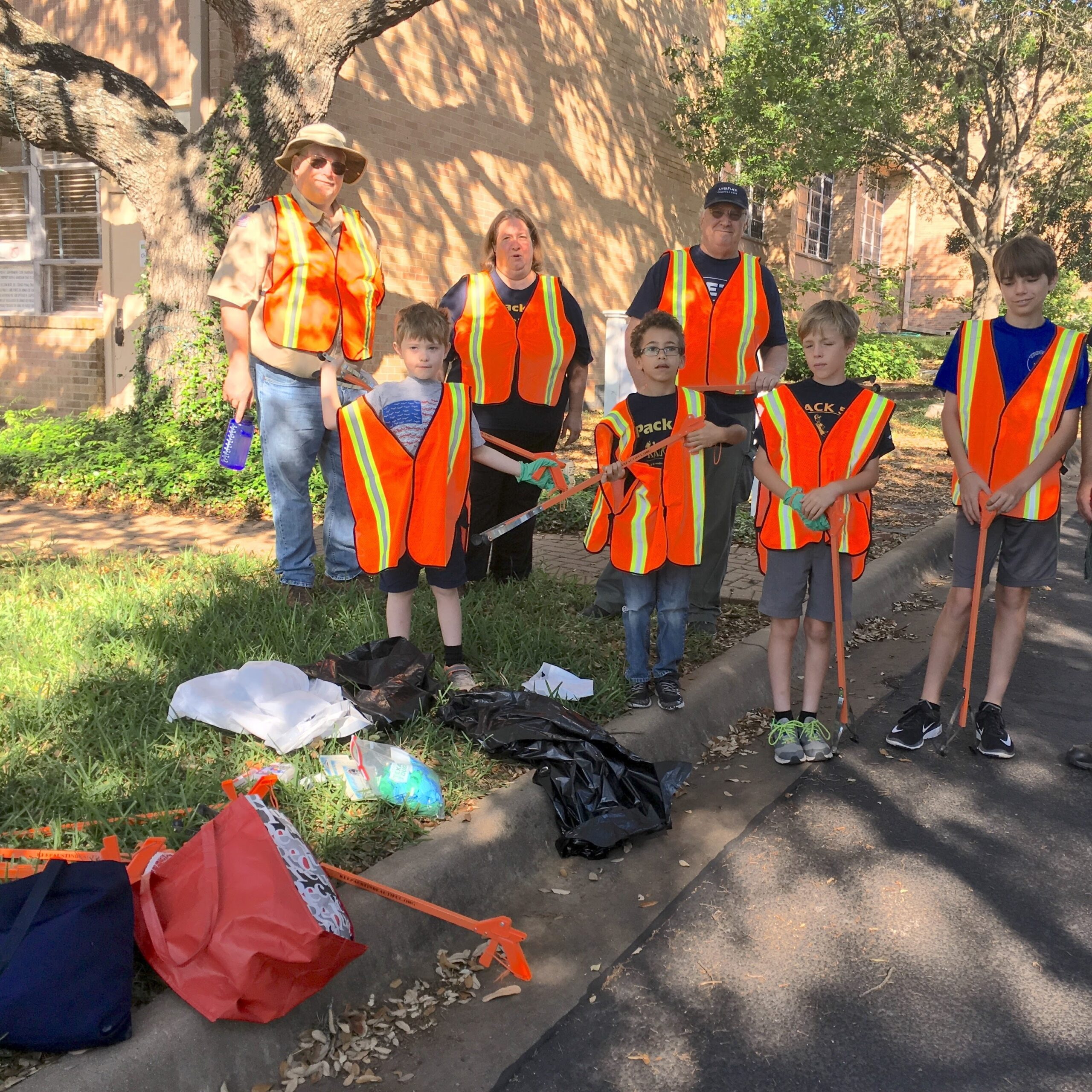 Pack 55 cub scouts and parents pick up trash on Balcones Drive