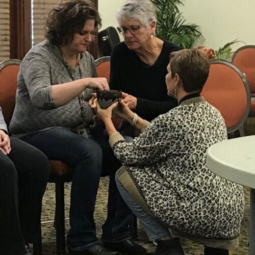 Teresa Nuckols serves communion at Womanfest