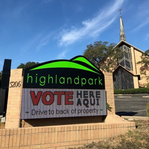 "Highland Park sign which reads ""vote here"""