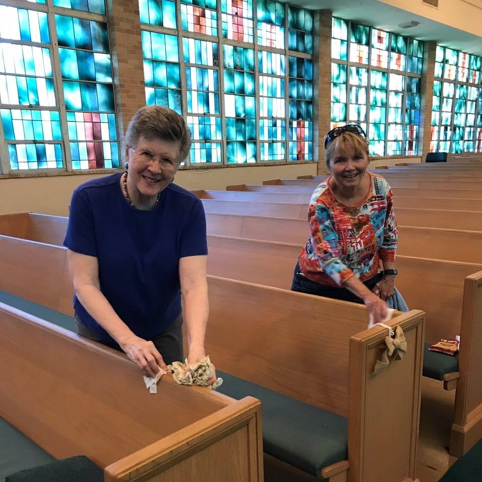 Margaret Stafford and Ouida Hartman polish Sanctuary pews on workday