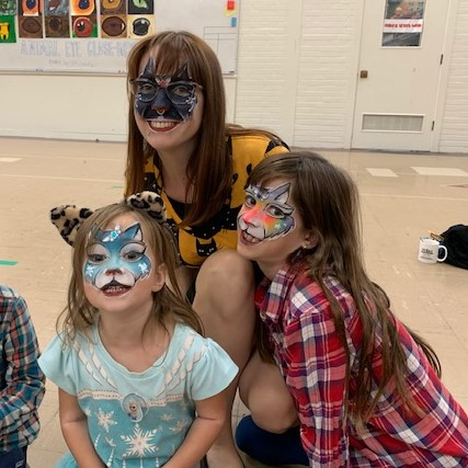 Hannah, Katalina, and Thyra Neas with faces painted at Harvest Festival