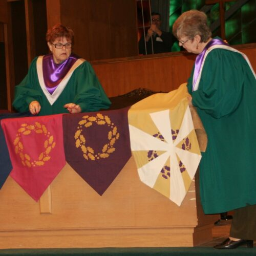 Sue Enoch & Carolyn Coleman lay advent altar banners