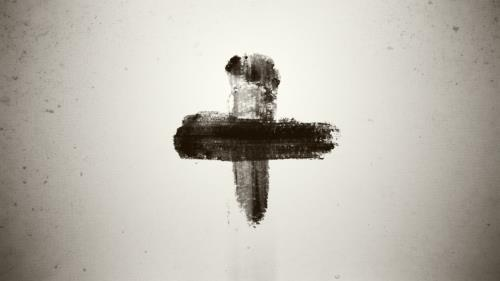 Ashes in sign of a cross