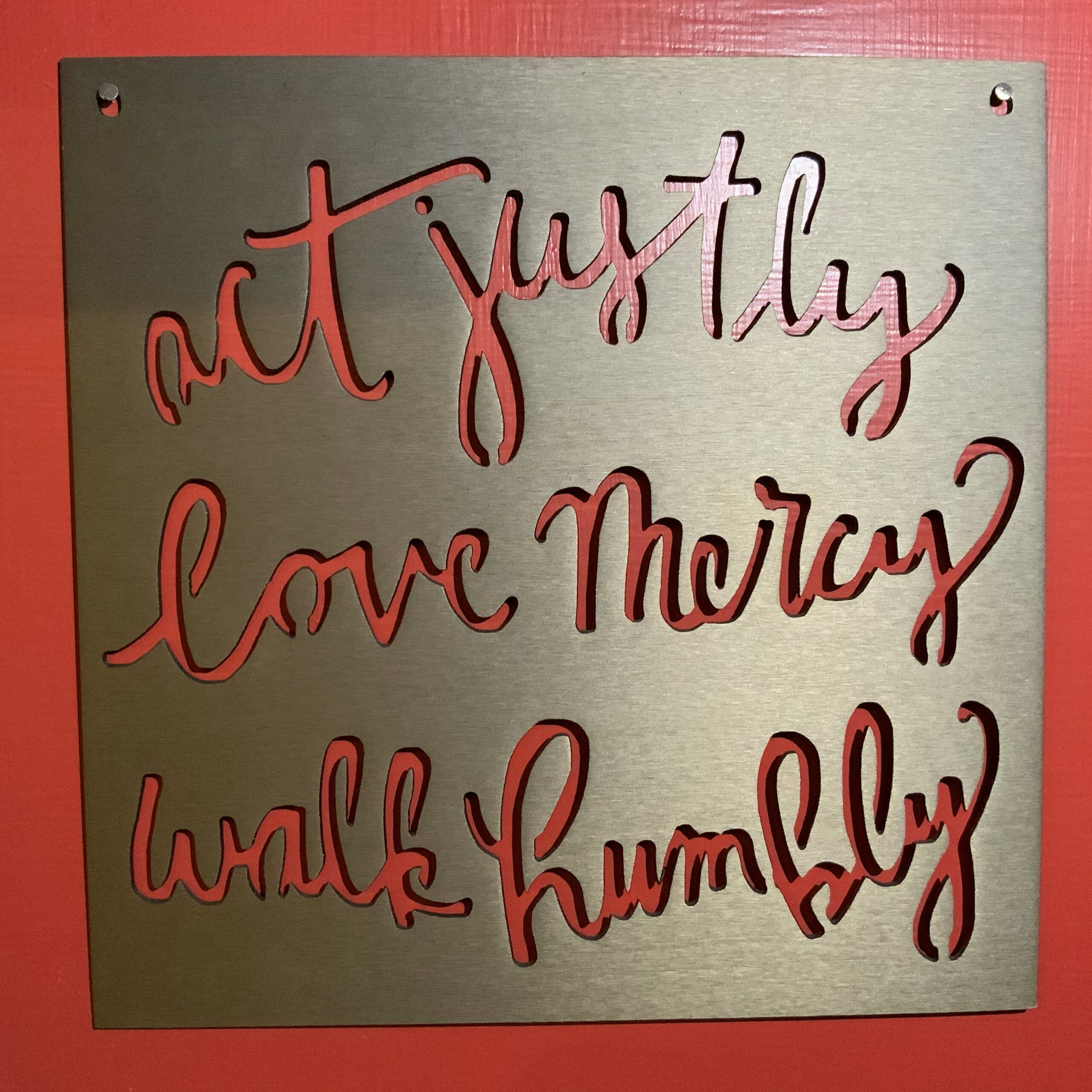 metal sign reading act justly, love mercy, walk humbly