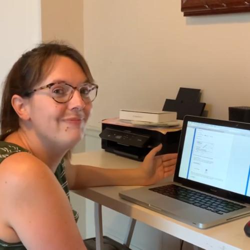 Hannah Neas shows work on computer